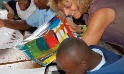 This is Gloria painting with Simon, Fahima and Jeff in 2009 at The City Primary School
